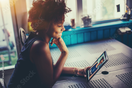 Laughing cute young black girl with perfect smile and dimples sitting at the kit Tablou Canvas
