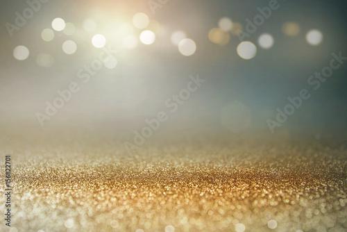Photo  Vintage glitter gold, dark blue and black lights bokeh background