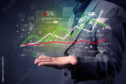 Fototapeta Businessman holding stock data obraz