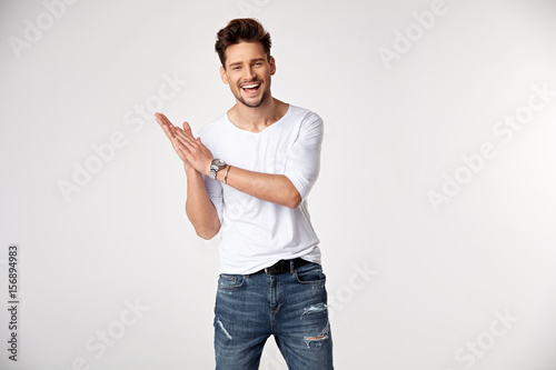 Handsome young man posing in studio - isolated