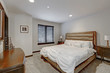 Master bedroom interior with queen size bed