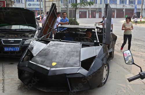 People Look At A Hand Made Replica Of Lamborghini Reventon In Suqian