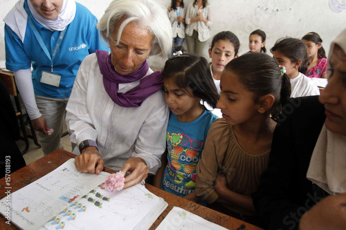 Christine Lagarde, IMF Managing Director, speaks to Syrian refugee