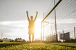 Successful soccer player laughed up his arms to the sky