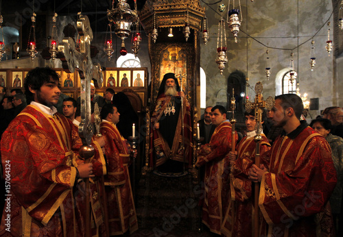 greek orthodox patriarch of jerusalem metropolitan theophilos leads the orthodox christmas procession inside the church of - When Is Greek Orthodox Christmas
