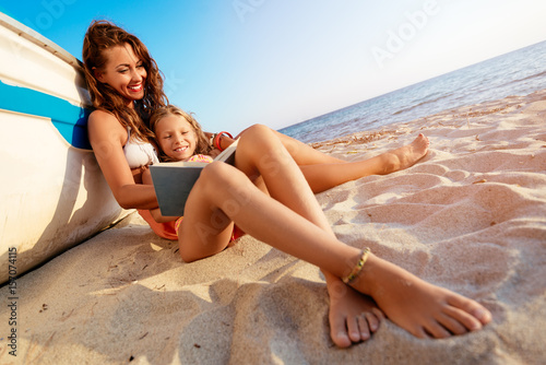 Poster  Mom And Daughter Enjoying On The Beach