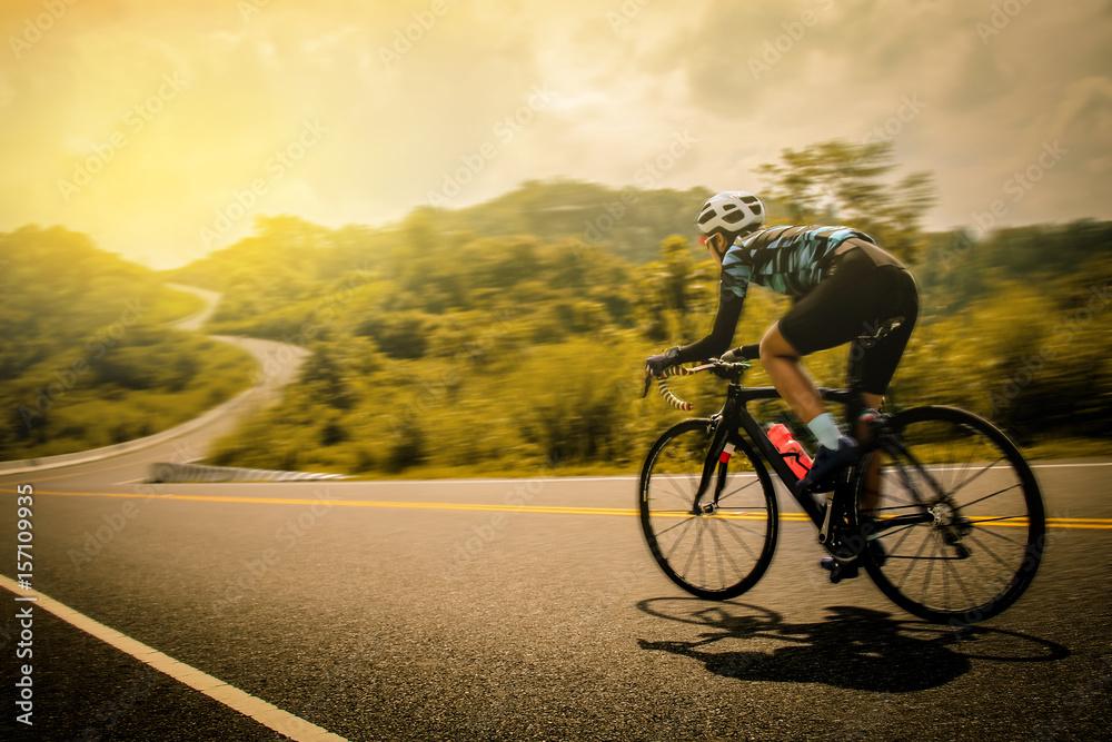 Fototapeta Women cycling mountain road bike in the morning