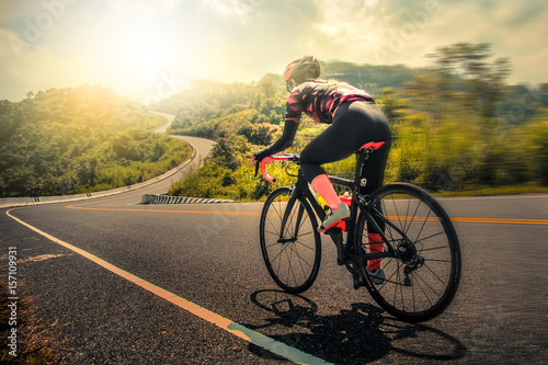 Women cycling mountain road bike in the morning