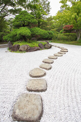 Fototapeta Zen stone path at Japanese green garden in summer