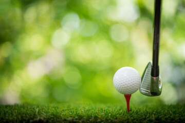 tee off with golf club