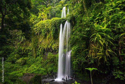 Layered water flows, cool air and green scenery are attractions that tourist can enjoy when they visit Tiu Kelep waterfall in Lombok, Indonesia.