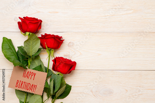 Happy Birthday Greeting Text On Craft Paper Card With Red Roses And Copy Space