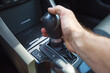 A man's hand on an automatic gearbox. Automatic shift transmission.