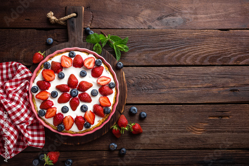 Fotografia, Obraz  Delicious strawberry pie with fresh blueberry and whipped cream on wooden rustic