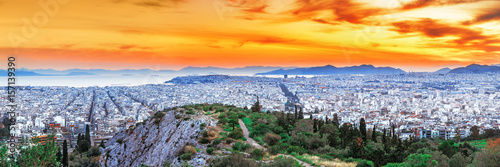 Athens, panoramic view from above. Sunset scenery with glowing orange dramatic sky, view from above. Athens is ancient city and the capital of Greece, Europe Union country.