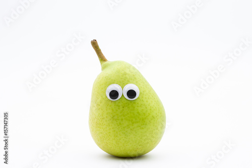 green pear with googly eyes on white background - pear face
