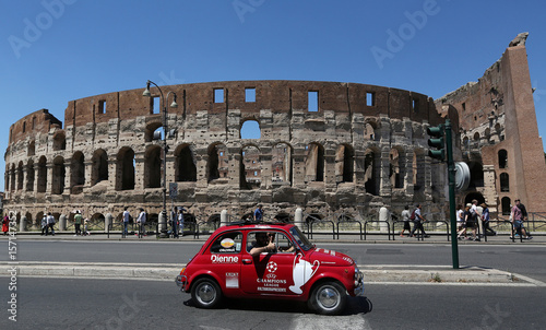 Juventus Supporters Drive An Old Fiat 500 In Front Of Ancient