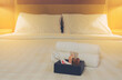 Hotel towel set with toothbrush and toothpaste on white bed