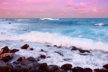 Panel Szklany Romantyczny Beautiful pink tinted waves breaking on a rocky beach at sunrise on east coast of Big Island of Hawaii