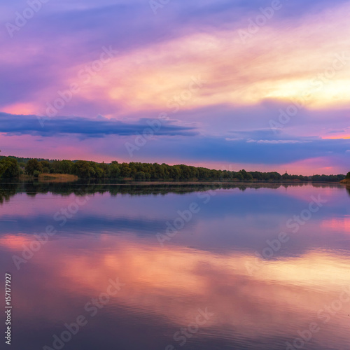 Spoed Foto op Canvas Zalm Vivid scenery of sunset at the river, colorful, dramatic evening sky reflected in the water, hdr image. Khmelnytskyi, Ukraine