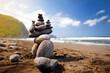 Stack of stones balanced on rocky beach of Pololu Valley, Big Island, Hawaii