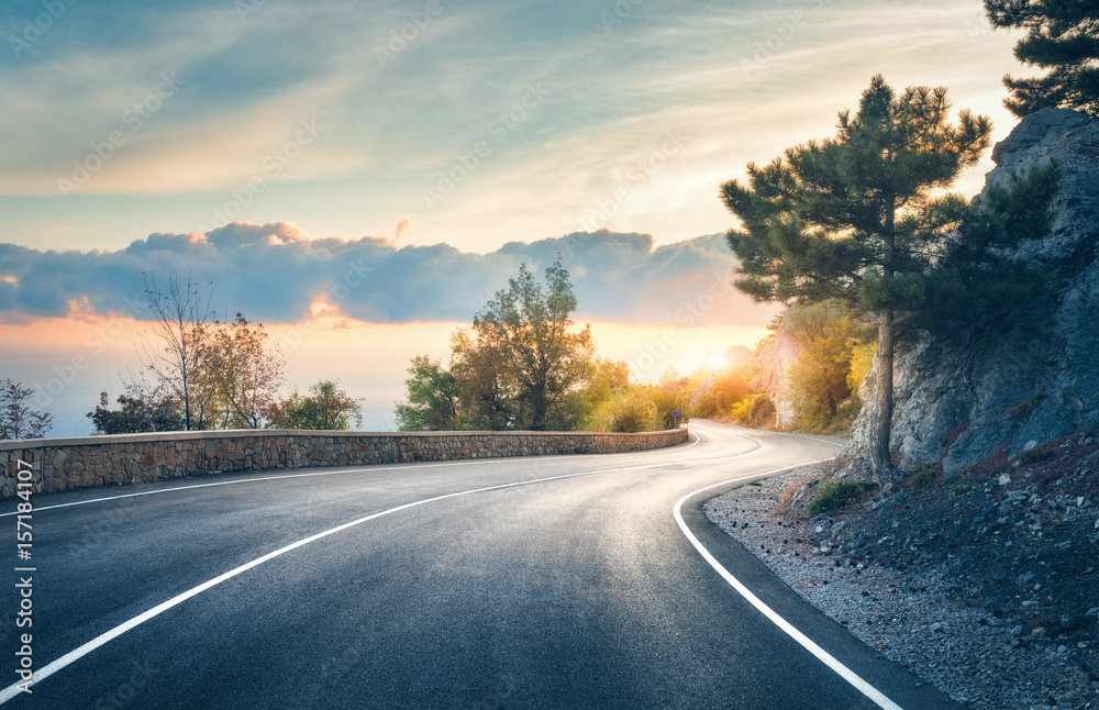 Fototapety, obrazy: Mountain road. Landscape with rocks, sunny sky with clouds and beautiful asphalt road in the evening in summer. Vintage toning. Travel background. Highway in mountains. Transportation
