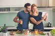 Young couple cooking together meal preparation indoor