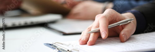 Fotografía  Hand of businessman signing document with pen