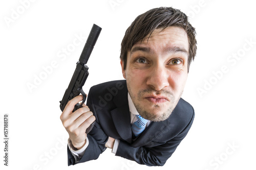 Fototapeta Young agent or murderer with gun with silencer in hand