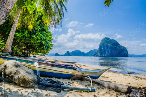 Fishing Boat And Net On Shore Under Palms Tropical Island Landscape El Nido