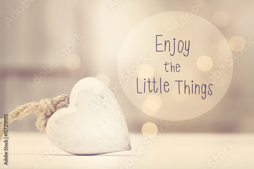Photo  Enjoy The Little Things message with a white heart