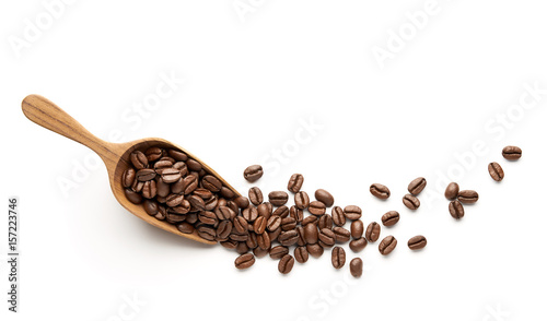 Coffee beans on wooden scoop isolated on white background - 157223746