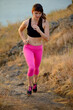 Young Woman Running on the Morning Mountain Trail. Active Lifestyle Concept.
