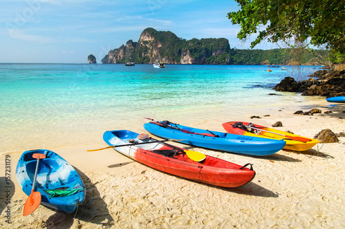 Foto auf Leinwand Gelb Amazing view of beautiful beach with kayaks on the sand. Location: Phi Phi Island, Krabi province, Thailand, Andaman Sea. Artistic picture. Beauty world.