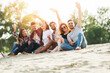 canvas print picture Group of young people having fun outdoors on the beach
