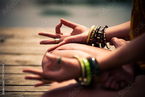 Staande foto School de yoga woman in a meditative yoga position closeup outdoor