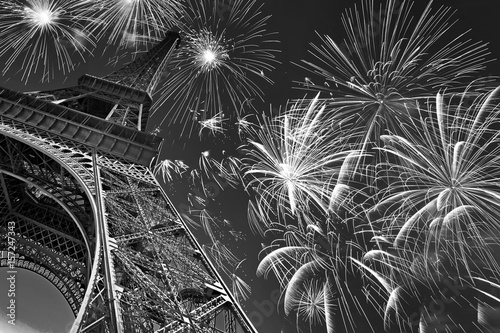 Eiffel tower at night with fireworks, french celebration and party, black and white image, Paris France