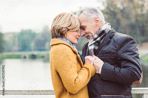 Fotografie, Obraz  Beautiful mature couple standing near lake