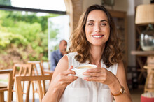 Mature Woman At Cafeteria