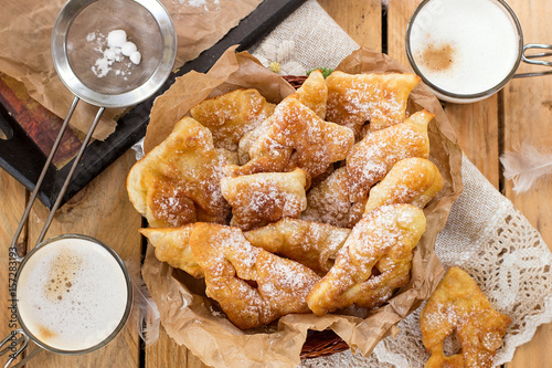 Fotografie, Obraz  Sweet crisp pastry Angel wings with powdered sugar