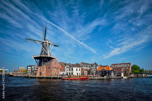 Photo  Harlem landmark  windmill De Adriaan on Spaarne river. Harlem,