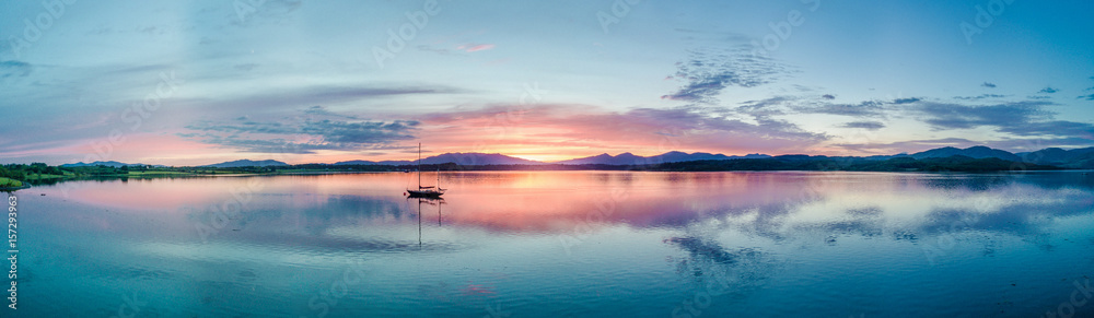 Fototapety, obrazy: Aerial of an amazing sunset with sailing vessel Loch Creran, Barcaldine, Argyll