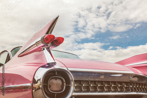 Foto op Canvas Vintage cars Rear end of a pink classic car