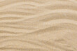 closeup of sand pattern of a beach in the summer for background