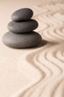 zen balance meditation stones. Pile of small rocks in the sand.