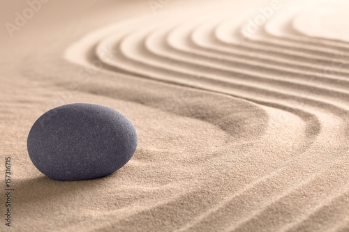 Garden Poster Stones in Sand Spa wellness relaxing background with round sone on sand.