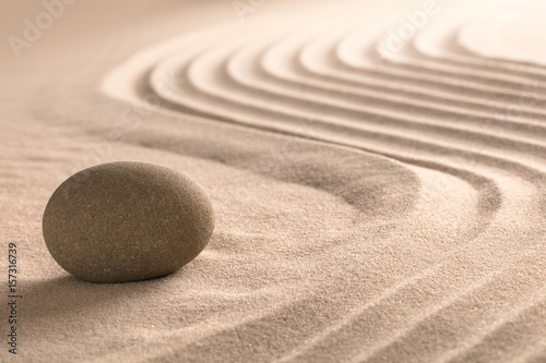 Garden Poster Stones in Sand Yoga meditation zen background. Sand texture and round stone. Spa wellness theme.