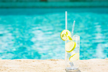 Water With Ice At The Edge Of A Resort Pool. Concept Of Luxury Vacation
