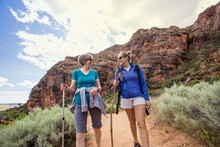 Women Hiking Together In A Bea...