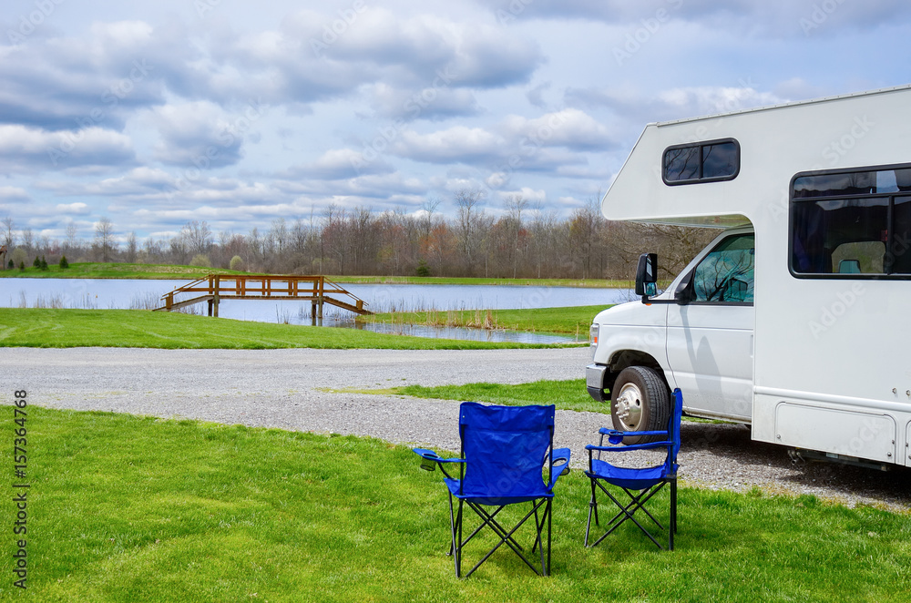 RV (camper) and chairs in camping, family vacation travel, holiday ...